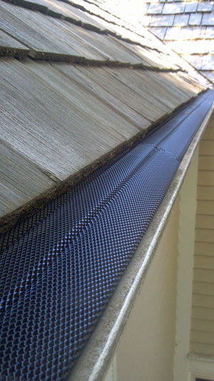 At $8 per foot installed the spring loaded micromesh is the best gutter protection for those homeowners with cedarshake roofs!